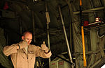 U.S. Air Force Tech. Sgt. Adam Nixon, a loadmaster assigned to the 746th Expeditionary Airlift Squadron (EAS), helps unload cargo from a C-130H Hercules aircraft at Pakistan Air Force Base Chaklala, Pakistan 100822-F-KV470-068.jpg