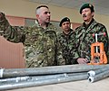 U.S. Army Maj. Renato Vieira, left, the 43rd Military Police Brigade rehabilitation chief for the Detention Facility in Parwan (DFIP), Afghanistan, shows part of the DFIP's vocational and technical facility to 120128-F-MJ568-044.jpg