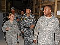 U.S. Army Staff Sgt. Shondale Gore, right, provides a tour of the support supply facility to Iraqi Col. Kareem, center, commander of the 4th Iraqi federal police division logistics battalion, at Camp Liberty 110501-A-XN207-043.jpg