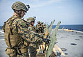 U.S. Marines assigned to Battalion Landing Team, 2nd Battalion, 5th Marine Regiment, 31st Marine Expeditionary Unit (MEU) grade targets during a live-fire exercise aboard the amphibious transport dock ship USS 140319-N-ZU025-208.jpg