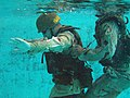 U.S. Marines practice water survival training in a swimming pool while in full battle dress at Combat Water Survival Swimming School in Camp Johnson, N.C., July 22, 2005 050722-M-FQ358-001.jpg