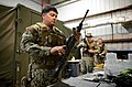 U.S. Navy Boatswain's Mate 1st Class Eddie Montalvo, left, assigned to Commander, Task Force (CTF) 56, reassembles an M4 carbine during weapons training at Naval Support Activity Bahrain in Manama, Bahrain 140212-N-OU681-214.jpg