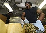 U.S. Navy Culinary Specialist 3rd Class Kenneth Williams slices a pineapple in the galley on the aft mess decks aboard the aircraft carrier USS Nimitz (CVN 68) July 30, 2013, in the Gulf of Oman 130730-N-TW634-056.jpg