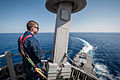 U.S. Navy Electronics Technician 3rd Class Tanner Huston looks out during an inspection May 23, 2013, at the top of the mast aboard the guided missile destroyer USS Stockdale (DDG 106) in the U.S. 5th Fleet area 130523-N-HN991-265.jpg
