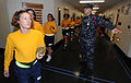 U.S. Navy Senior Chief Quartermaster Eric Bachtel, right, a recruit division commander at Navy Officer Candidate School, directs a group of new students 101023-N-IK959-485.jpg