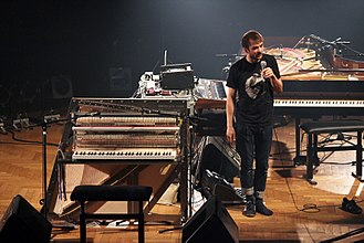 Nils Frahm - Nils Frahm and the Una Corda (front), Roland Juno-60 (behind him), Fender Rhodes (under the Juno-60), Roland RE-501 (on top behind the Juno-60), Moog Taurus (on the floor behind him) and other equipment.