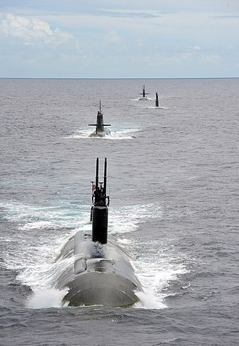 USS Charlotte, a Los Angeles-class submarine runs with submarines from partner nations during RIMPAC 2014. USS Charlotte (SSN 766) steams in a close formation at RIMPAC 2014.jpg