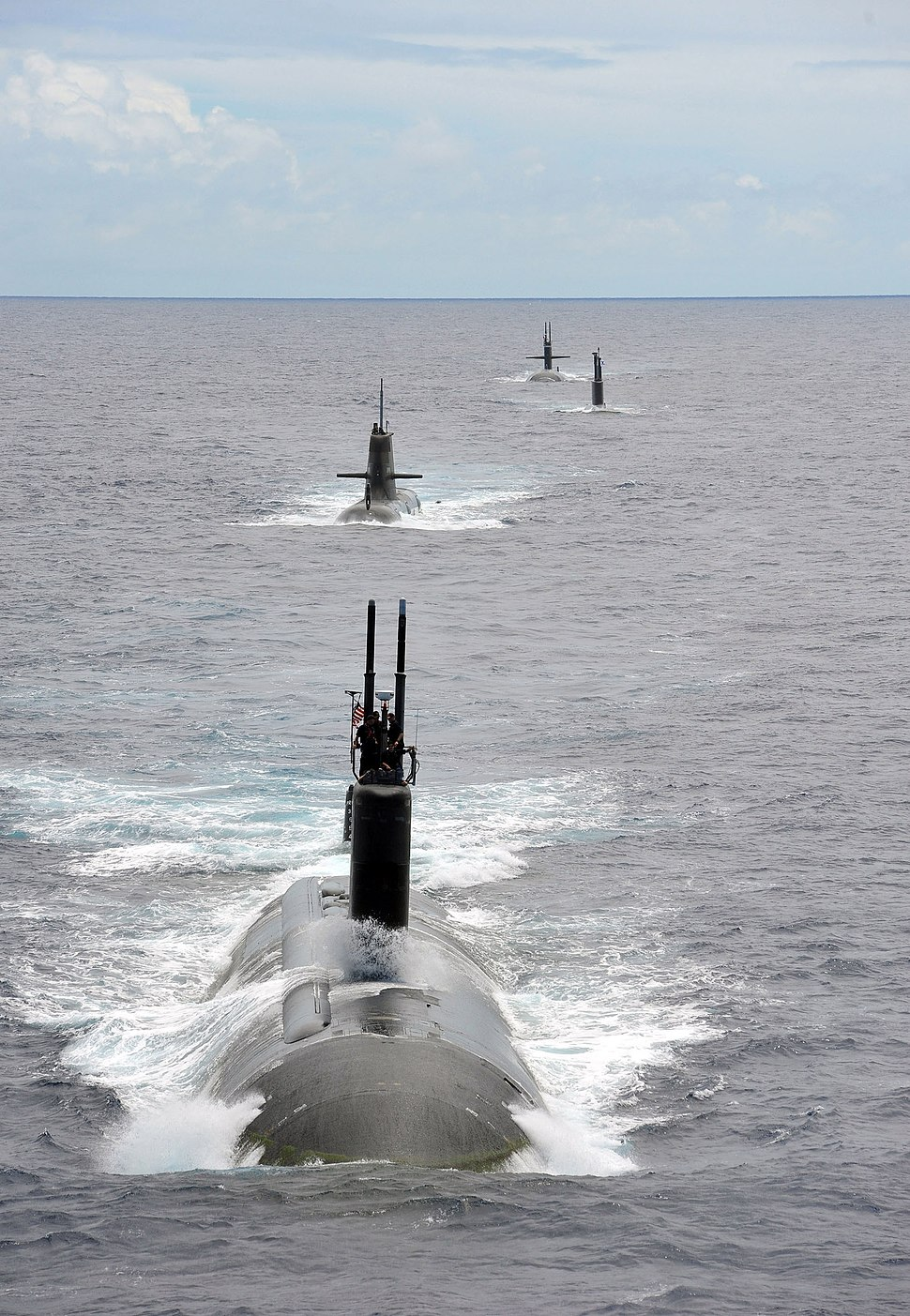 USS Charlotte (SSN 766) steams in a close formation at RIMPAC 2014