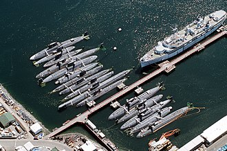 USS Seawolf (SSN-575) - Decommissioned submarines at Puget Sound in 1993.  Seawolf is the long hull, 2nd above the jetty, recognizable by the stepped sail and the unusual bow shape.