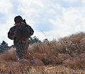 US Army paratrooper makes way to rally point 141209-A-QW291-125.jpg