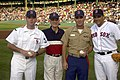 US Navy 020703-N-7422B-001 Torpedoman's Mate 3rd Class Brian Ryan, Secretary of the Navy Gordon England, U.S. Marine Captain Israel Garcia, and Boston Red Sox catcher Doug Mirabelli.jpg