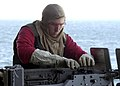 US Navy 020930-N-1159M-003 A Sailor loads a .50 caliber machine gun during a training exercise aboard the Abraham Lincoln.jpg