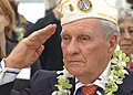 US Navy 031207-N-7391W-052 Authur Forcier, Hawaii's State Commander of the Disabled American Veterans, salutes the national ensign during the 62nd anniversary of the attack on Pearl Harbor.jpg