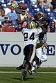US Navy 040925-N-9693M-010 U.S. Naval Academy Midshipman 1st Class Eric Roberts catches a pass under pressure from Vanderbilt's Marcus Bugss.jpg