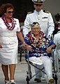 US Navy 041207-N-3019M-004 Mr. Ben Boosinger, a Pearl Harbor survivor, is escorted back to his seat after paying his respects during the 63rd commemoration of the Dec. 7, 1941 attack on Pearl Harbor, Hawaii.jpg