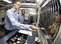 US Navy 041222-N-9079D-010 Disbursing Clerk 3rd Class Brandon Hendricks, from Everett, Wash., conducts transactions in the Disbursing office aboard USS Abraham Lincoln (CVN 72).jpg