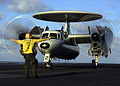 US Navy 050218-N-3241H-012 An Aviation Boatswain's Mate directs the pilots of an E-2C Hawkeye after a safe recovery during flight operations aboard the Nimitz-class aircraft carrier USS Carl Vinson (CVN 70).jpg
