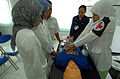 US Navy 050301-N-8629M-332 An Indonesian nurse practices cardio pulmonary resuscitation (CPR) under the instruction of Hospital Corpsman 3rd Class Lynette Shute.jpg