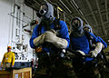 US Navy 051003-N-9742R-017 Hangar bay personnel deploy an Aqueous Film-Forming Foam (AFFF) hose during a fire drill.jpg