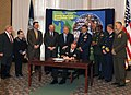 US Navy 060321-N-7987M-060 Rear Adm. Frederic Ruehe, signs a memorandum of understanding at Naval Amphibious Base Little Creek for the Hampton Roads Military and Civilian Family Violence Prevention Council.jpg