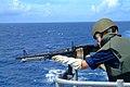 US Navy 060605-N-4772B-010 Midshipman 2nd Class John D. Jones gets small arms training on the bridgewing of the amphibious dock landing ship USS Harpers Ferry (LSD 49).jpg