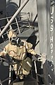 US Navy 060901-N-9851B-003 Hull Technician 3rd Class Marc Brandes wears an Advanced Chemical Protective Garment (ACPG) while leading an external survey team.jpg