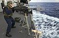 US Navy 060906-N-9851B-002 Gunner's Mate 2nd Class Justin Shea fires a Mark-19 40mm grenade launcher from the weather deck aboard the Arleigh Burke-class guided missile destroyer USS Hopper (DDG 70) during a familiarization fir.jpg