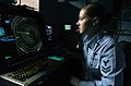 US Navy 061209-N-5248R-001 Air Traffic Controller 2nd Class Emmily Trolinger from Farmington, Mo., stands watch as aircraft departure controller in Carrier Air Traffic Control Center.jpg