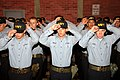 US Navy 070814-N-8848T-071 Recruits from Division 253 place Navy ball caps on their heads during a capping ceremony after ending training for Battle Stations 21 on board USS Trayer (BST 21) at Recruit Training Command.jpg