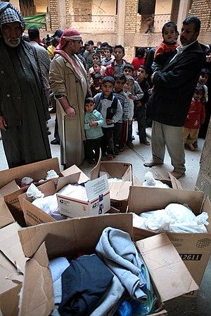 Irakiska flyktingar i kö för hjälp