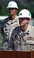 US Navy 071221-N-7367K-011 Lt. Cmdr. Michael Mihaly, officer in charge of Naval Mobile Construction Battalion (NMCB) 1, Guam Det., gives a speech while Senior Chief Builder E. Dan Walker, the detachment's senior enlisted leader.jpg