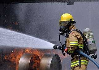 Firefighter rescuer trained to extinguish hazardous fires