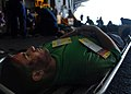 US Navy 080904-N-9079D-199 A simulated casualty waits to be assisted during a mass casualty drill aboard the Nimitz-class aircraft carrier USS Abraham Lincoln (CVN 72).jpg