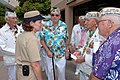 US Navy 080916-N-5422G-233 Command Master Chief Kathleen A. Hansen talks with Pearl Harbor survivors.jpg