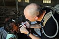 US Navy 080920-N-4515N-273 Maj. Darin Gunnink, a medical augmentee embarked aboard the amphibious assault ship USS Kearsarge (LHD 3), gives a child de-worming medication during disaster relief efforts in Haiti.jpg