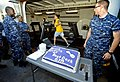US Navy 090604-N-5345W-015 Damage Controlman 2nd Class Tiffany Stevens takes a test run on one of the treadmills in the new boat-deck gym during a ribbon and cake cutting ceremony.jpg