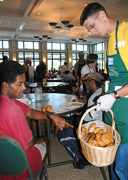 File:US Navy 100830-N-5647H-054 Airman Bryan Pickett serves bread to the community of the Daily Bread Soup Kitchen as part of Baltimore Navy Week.jpg