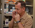 US Navy 100916-N-2729A-104 Capt. Stephen Pachuta self-administers the nasal spray flu immunization FluMist during an immunization clinic at U.S. Na.jpg