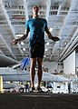 US Navy 101004-N-6427M-149 Airman David Hall, from Buffalo, N.Y., jumps rope during a training session in the hangar bay aboard the aircraft carrie.jpg