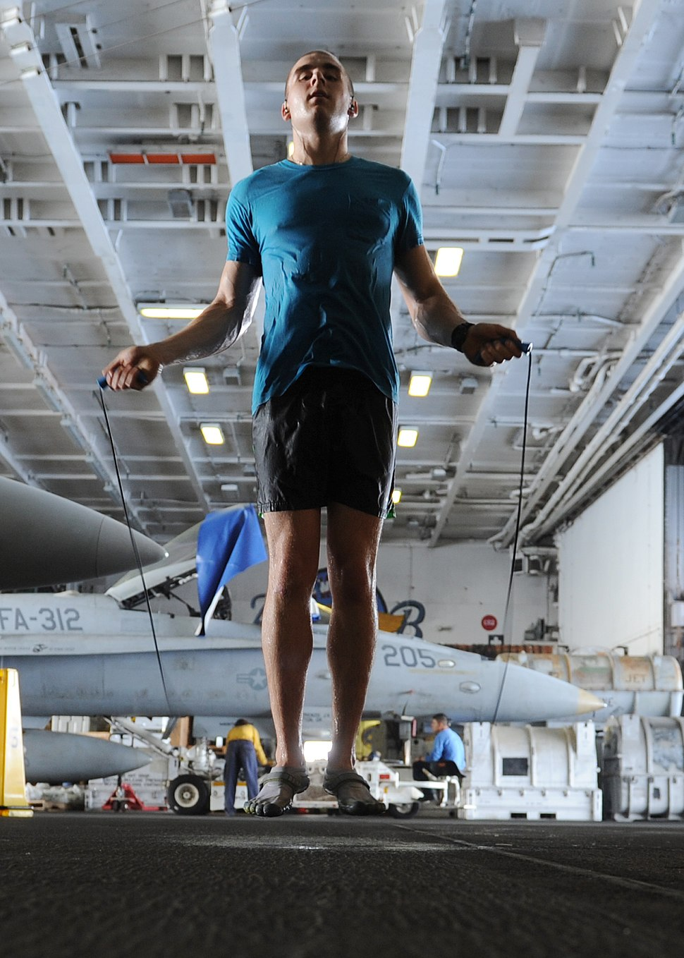 US Navy 101004-N-6427M-149 Airman David Hall, from Buffalo, N.Y., jumps rope during a training session in the hangar bay aboard the aircraft carrie