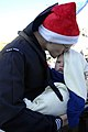 US Navy 101220-N-5292M-563 Fire Controlman 2nd Class Matt Tannehill kisses his 5-month-old son during a homecoming celebration for the guided-missi.jpg