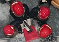 US Navy 110308-N-EA192-067 Sailors apply a bucket patch to a simulated ruptured bulkhead during a damage control exercise at the Yokosuka Center fo.jpg
