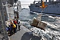 US Navy 110322-N-SF508-227 Sailors aboard the Ticonderoga-class guided-missile cruiser USS Shiloh (CG 67) receive cargo from the Military Sealift C.jpg