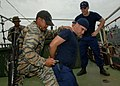 US Navy 110701-N-NJ145-261 Philippine navy sailors practice search and detain operations while participating in a tactical boarding training exerci.jpg