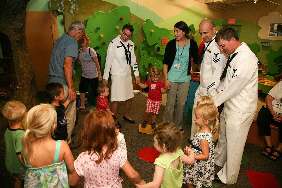 US Navy 110831-N-YM440-026 Sailors take part in Story Tree Time at Duke Energy Children's Museum during Cincinnati Navy Week 2011, one of 21 Navy W