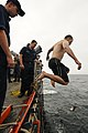 US Navy 110920-N-YM590-344 Gas Turbine Systems Technician (Electrical) Fireman Apprentice William Anderson jumps from the fantail of USS Anzio (CG.jpg