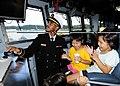 US Navy 111112-N-WJ771-176 Ensign Roberto J. Johnson entertains Japanese children on the bridge of the forward-deployed amphibious dock landing shi.jpg