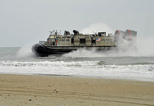 US Navy 120206-N-KB666-299 A landing craft air cushioned (LCAC) from the amphibious assault ship USS Kearsarge (LHD 3) comes ashore during an amphi.jpg