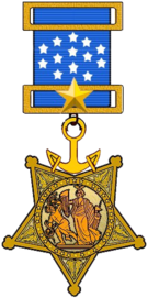 A gold star shaped military medal hanging from a blue ribbon with white five-pointed stars