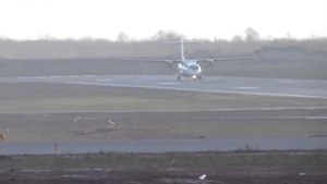 File:UTair ATR 72 landing at Lviv International Airport in strong crosswinds.ogv